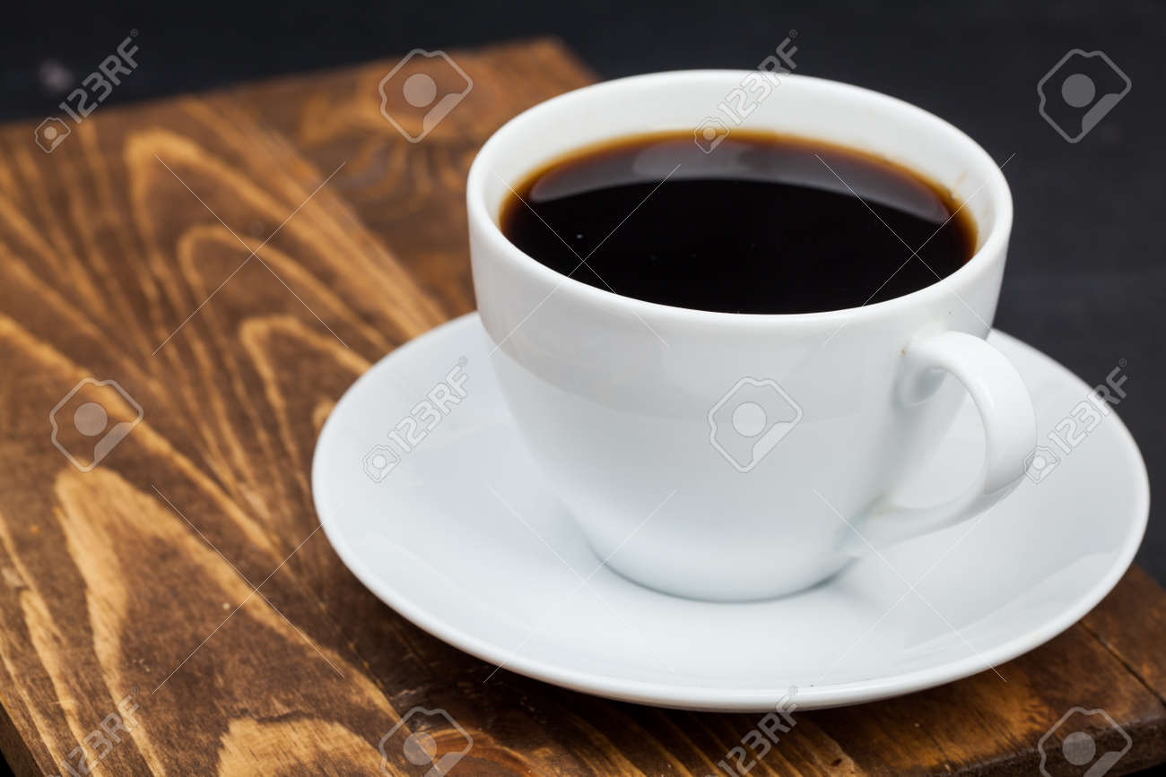 Cup of tea on wood surface - 141284594