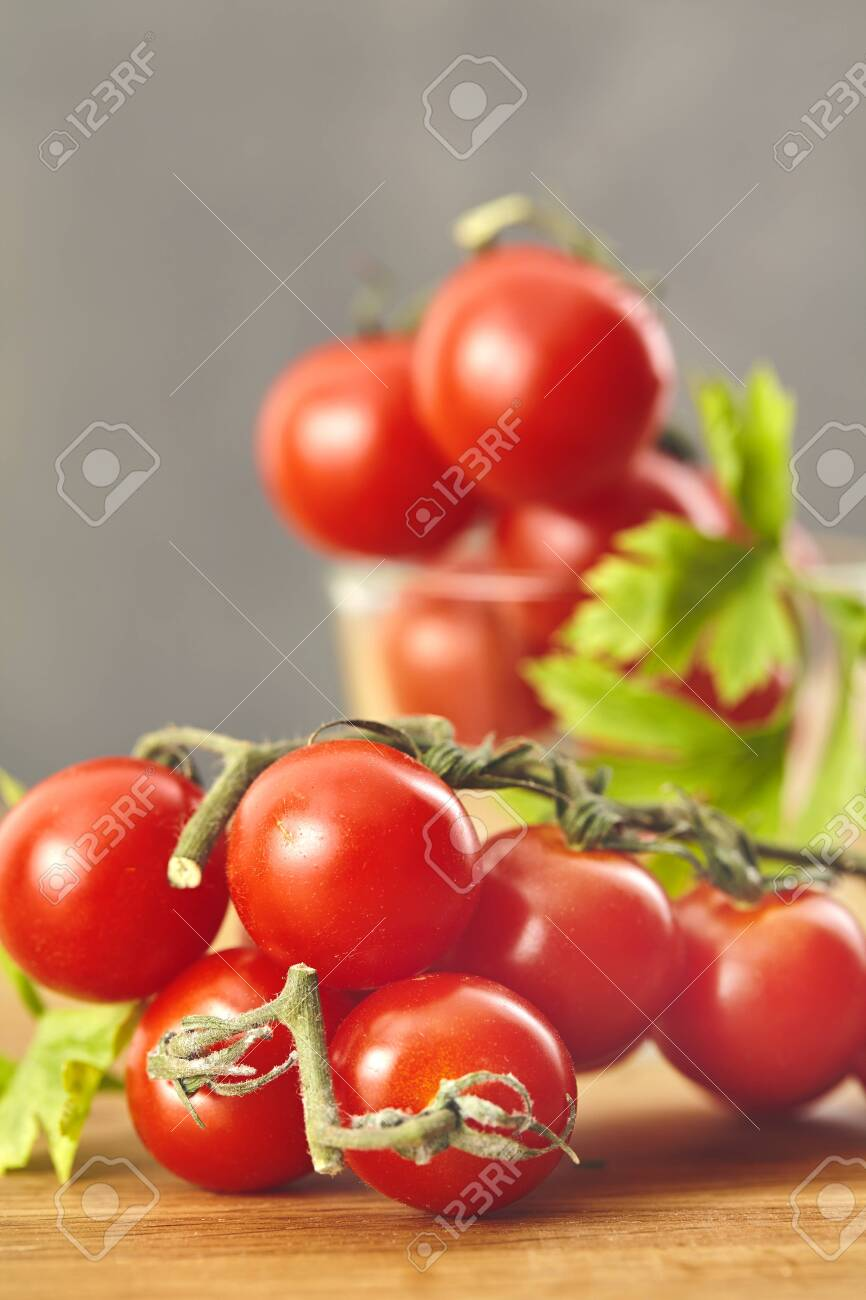 Fresh cherry tomatoes on a wooden table. Selective focus - 147361146