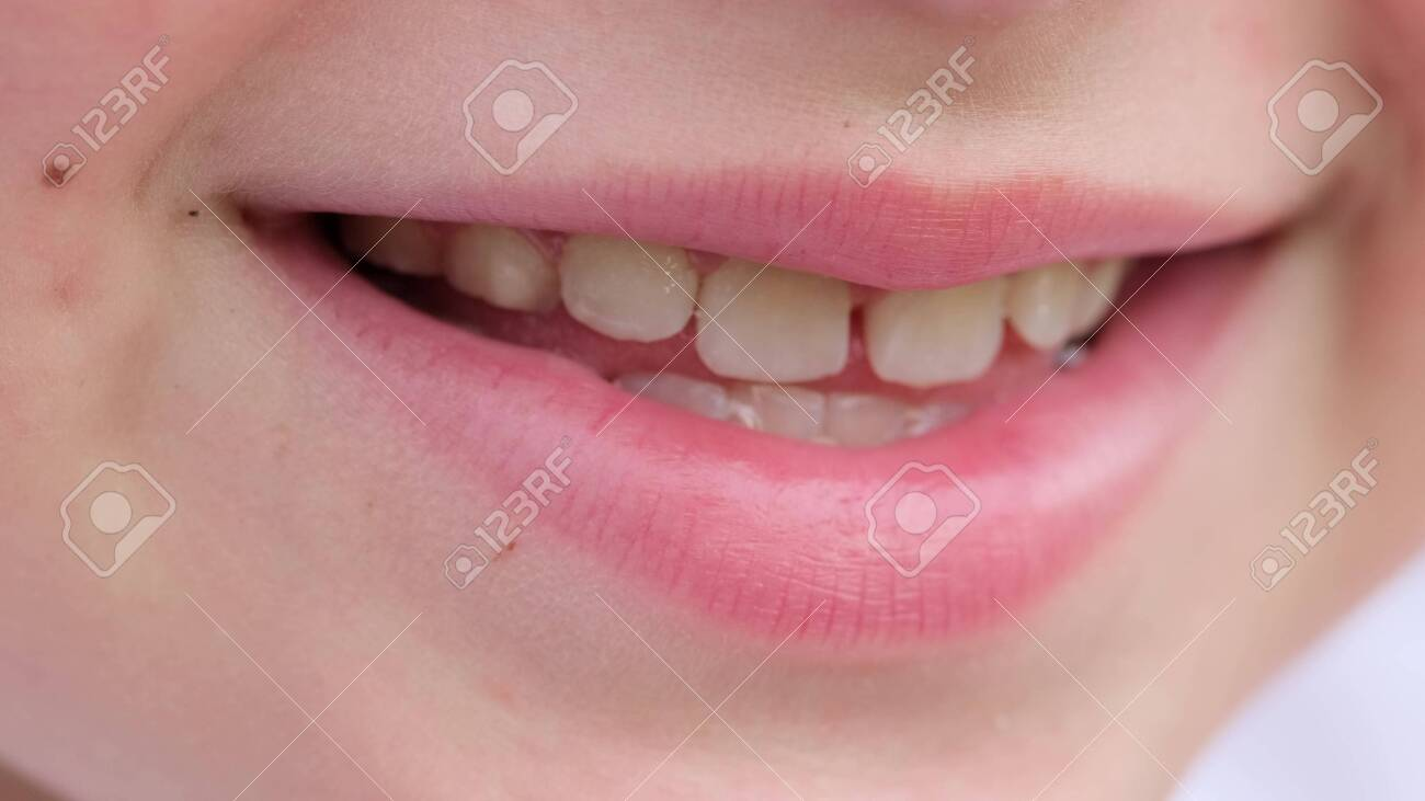 portrait of smiling teenager carefully looking at the camera. close-up - 153898566