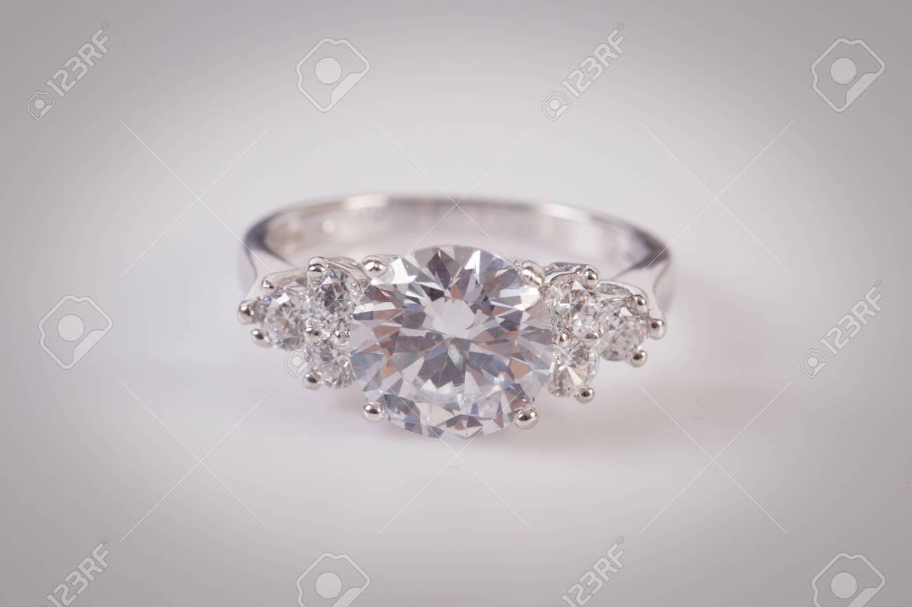 Close up of elegant diamond ring on the white background. Diamond ring. - 137065933
