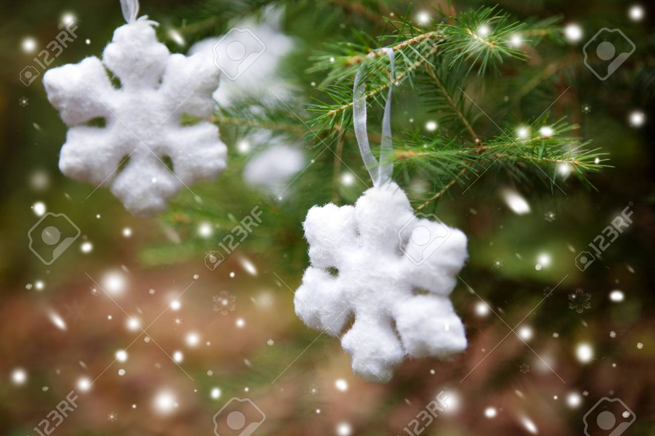 Snowflake On A Christmas Tree Season Greetings Stock Photo Picture