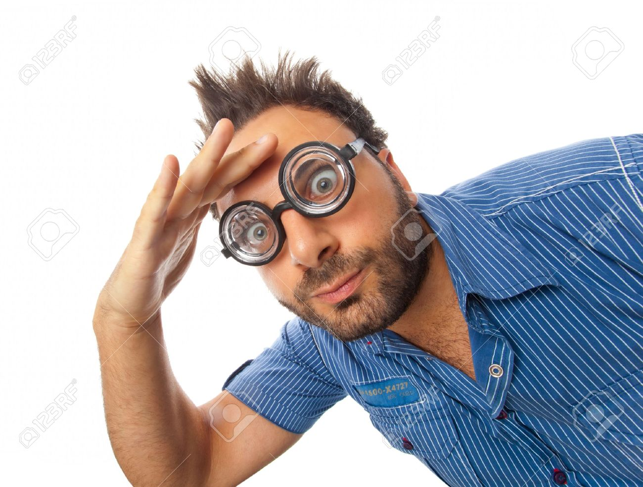 Young boy with a surprised expression with eye glasses - 20718453