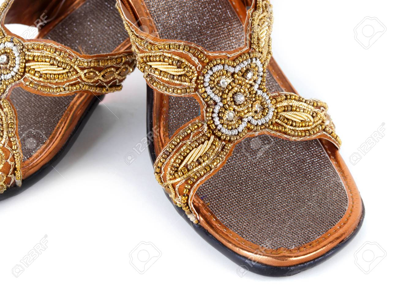 ef4c3501b2e9 Pair of traditional Indian sandals on white background Stock Photo -  24199591
