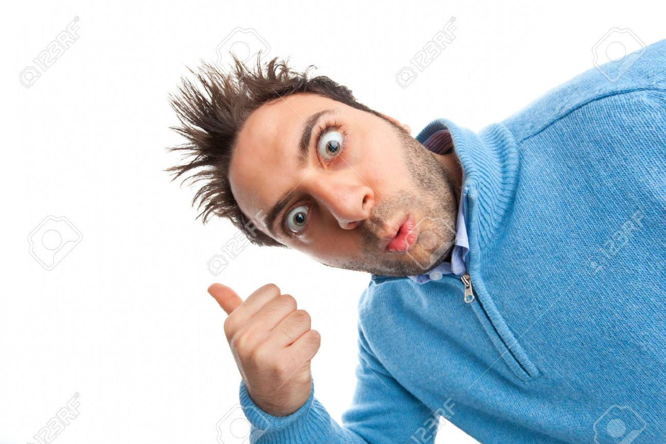 Young boy with a surprised expression pointing on white background Stock Photo - 27247421