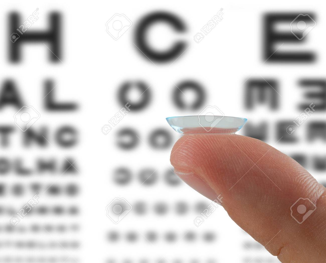 Contact lens on finger on the table for the checking eyesight Stock Photo - 27247447