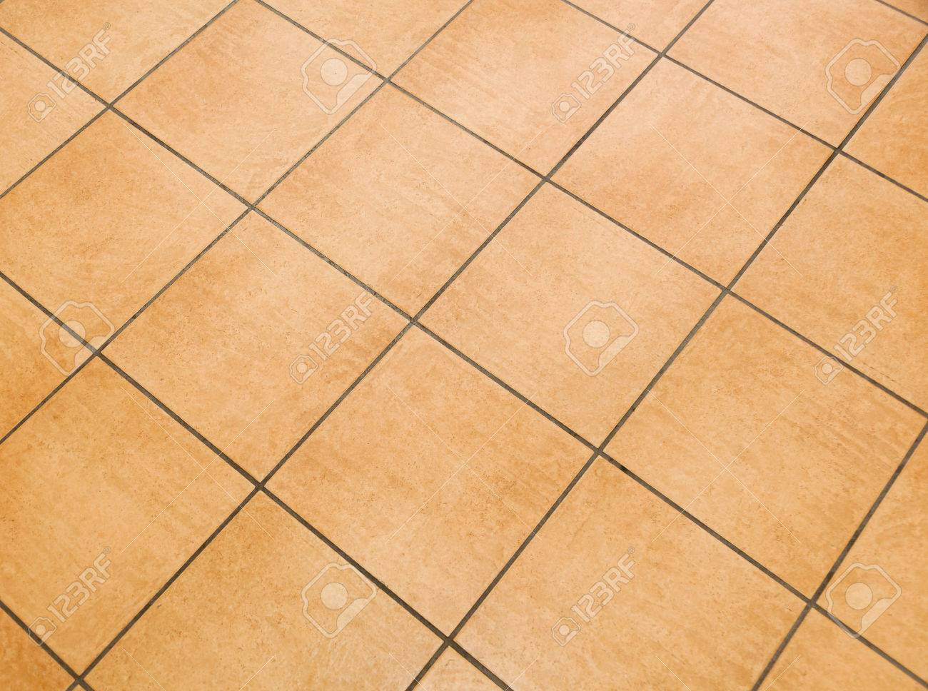 Brown Ceramic Floor Tiles Close Up Texture Stock Photo