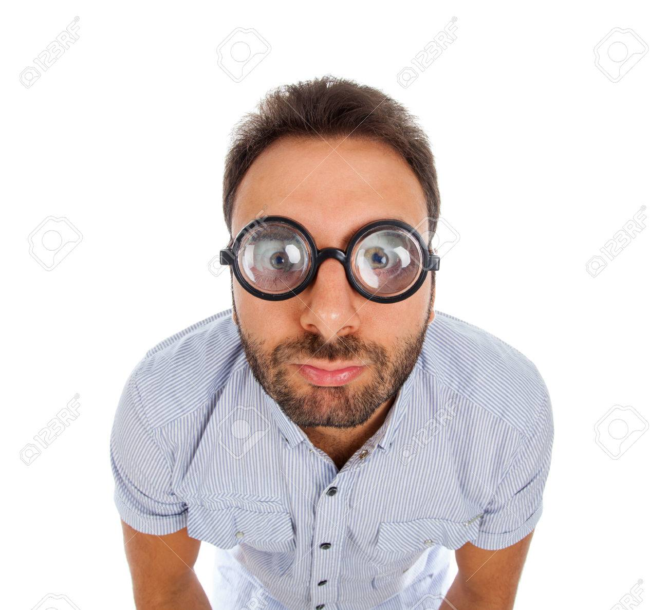 Young Man With A Surprised Expression And Thick Glasses On White ...