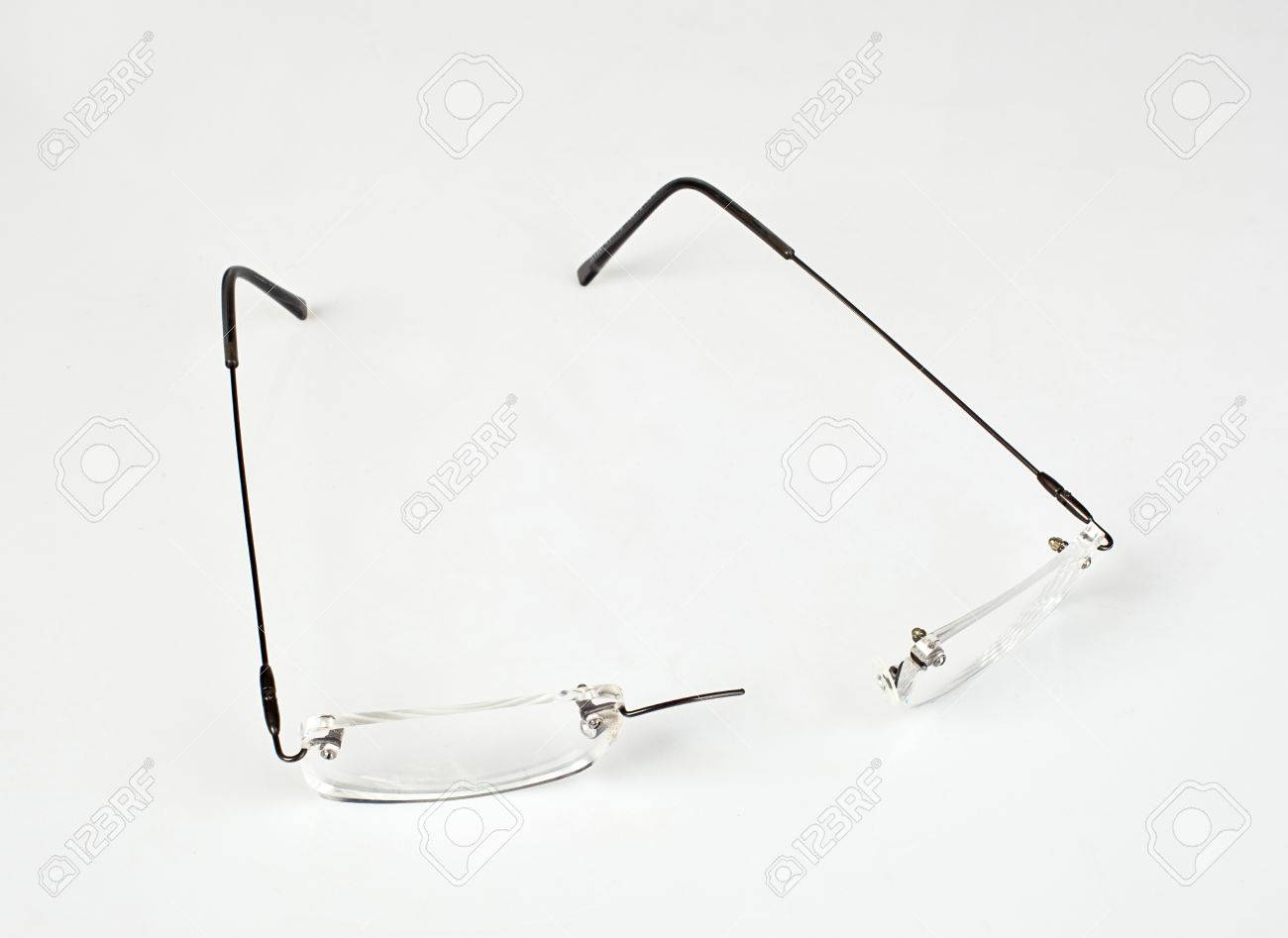 Eyeglasses With Lightweight Frame Broken On White Table. Stock Photo ...