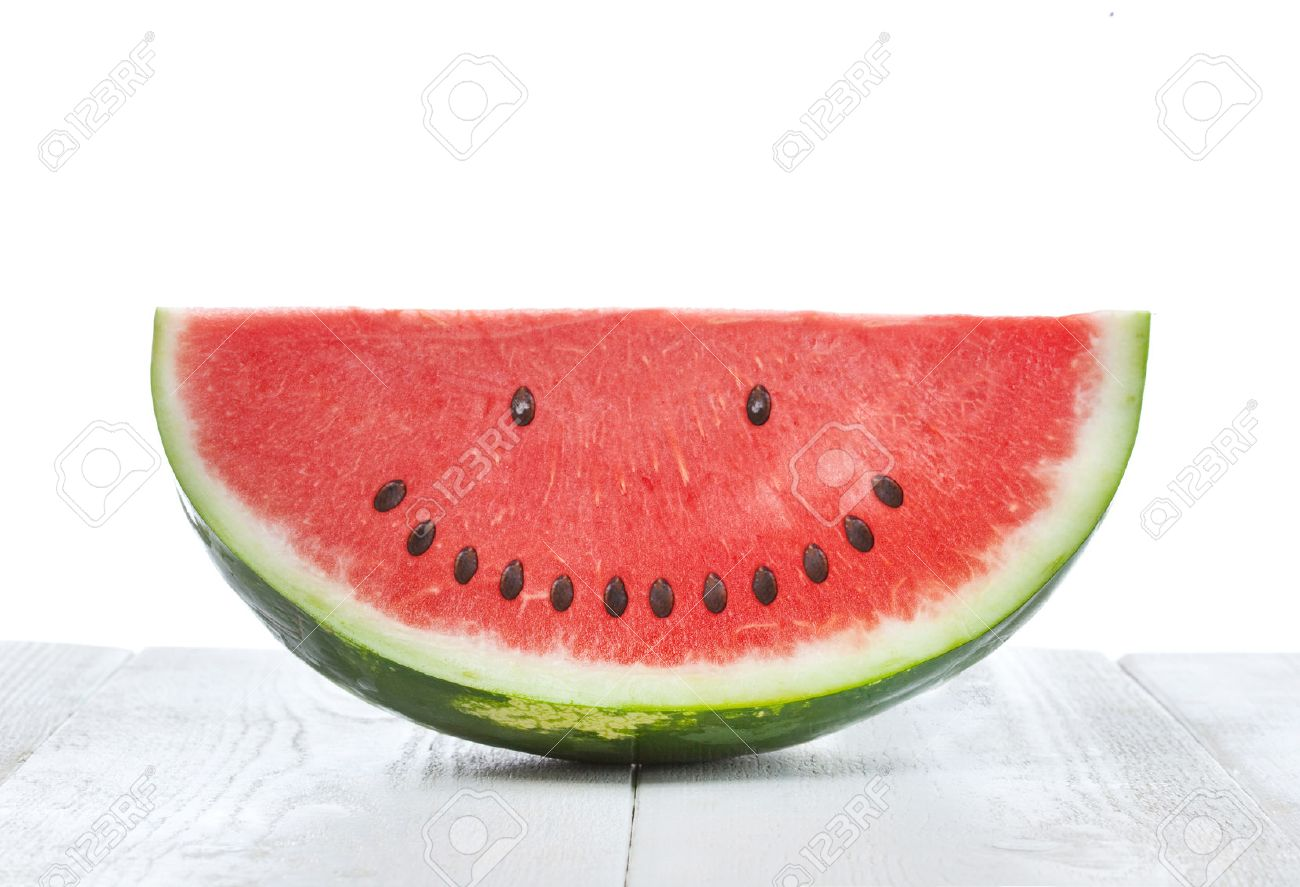 Slice of watermelon with seeds that make a smiling face - 41127351