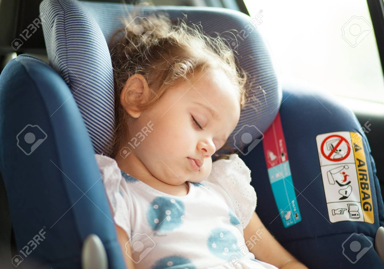 Cute Blond Baby Sleeping In Car Seat Safety Concept Stock Photo
