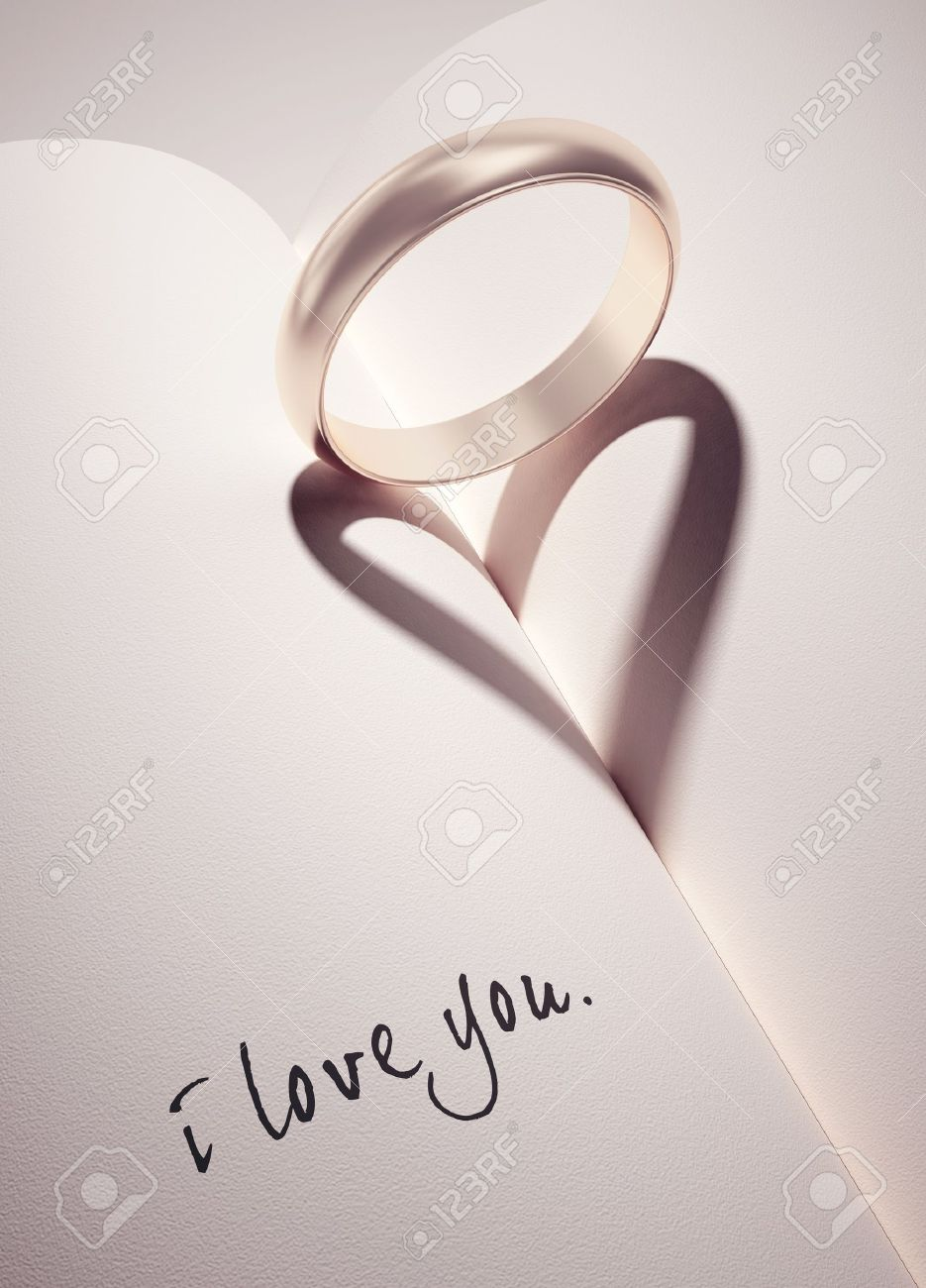 heartshadow with rings on a book middle - i love you - card Stock Photo - 10785017
