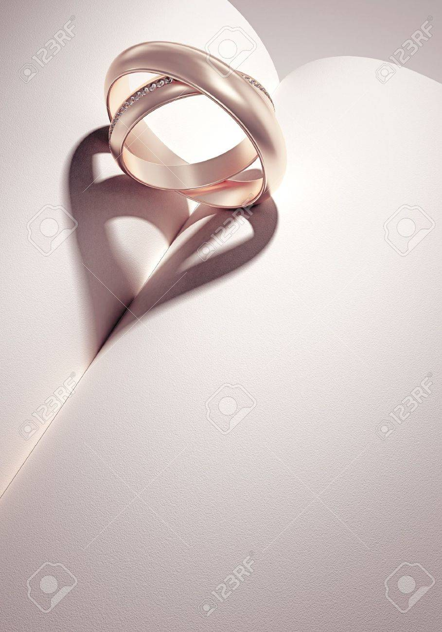 heartshadow with rings on a book middle - card - write your text in white space Stock Photo - 10785058
