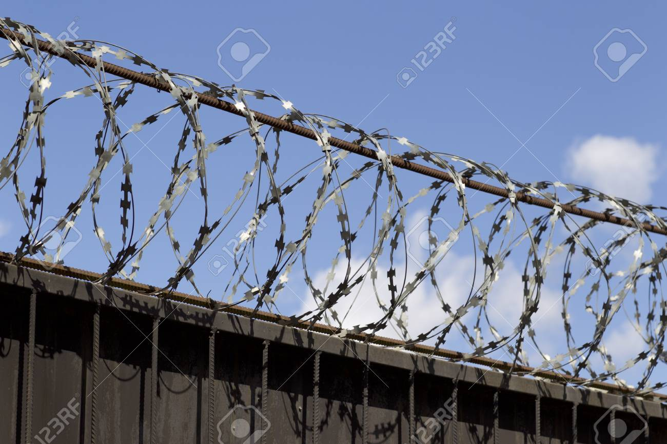 Barbed Wire Wound To The Top Of A Fence, Russia Stock Photo, Picture ...