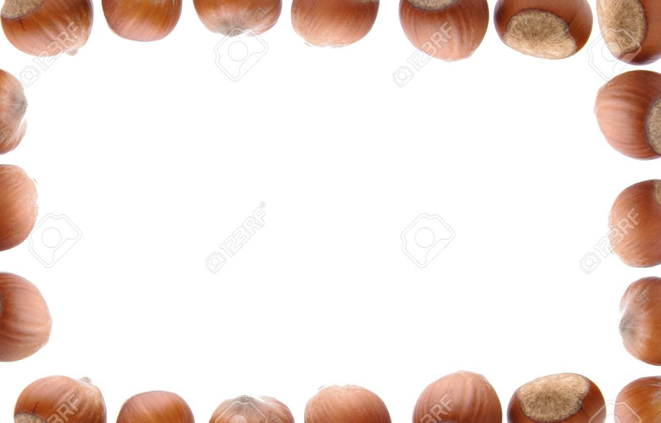 Isolated frame of hazelnuts Stock Photo - 4465343