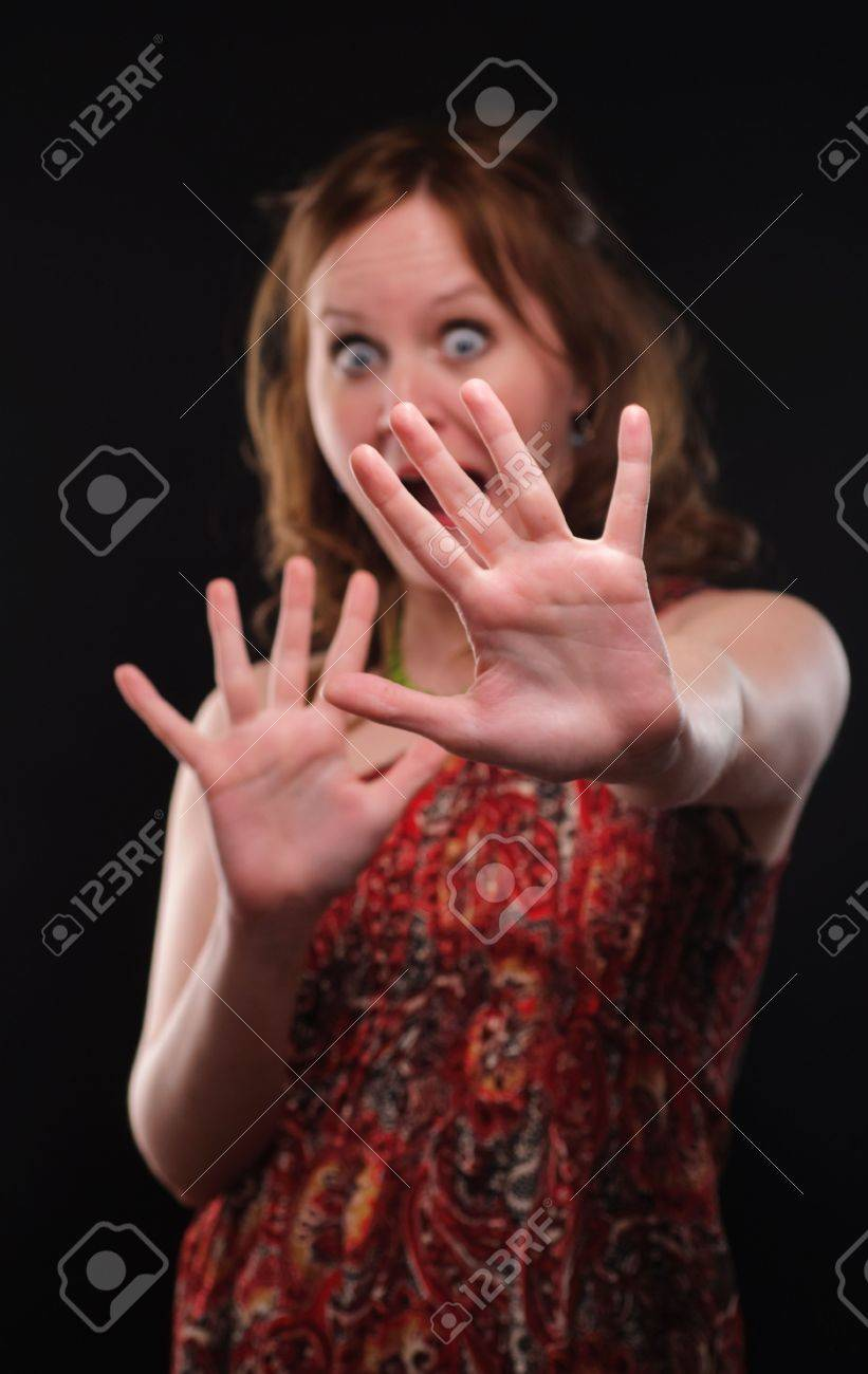 Woman gesturing stop sign. Focus on arm. Stock Photo - 6828566