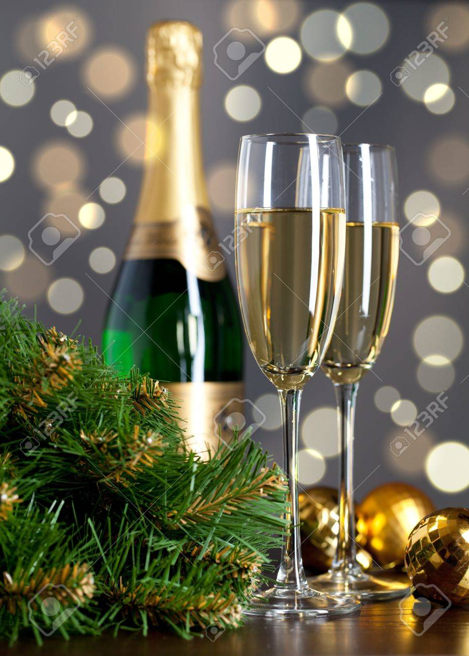 Two full glasses of champagne over color background Stock Photo - 8618089