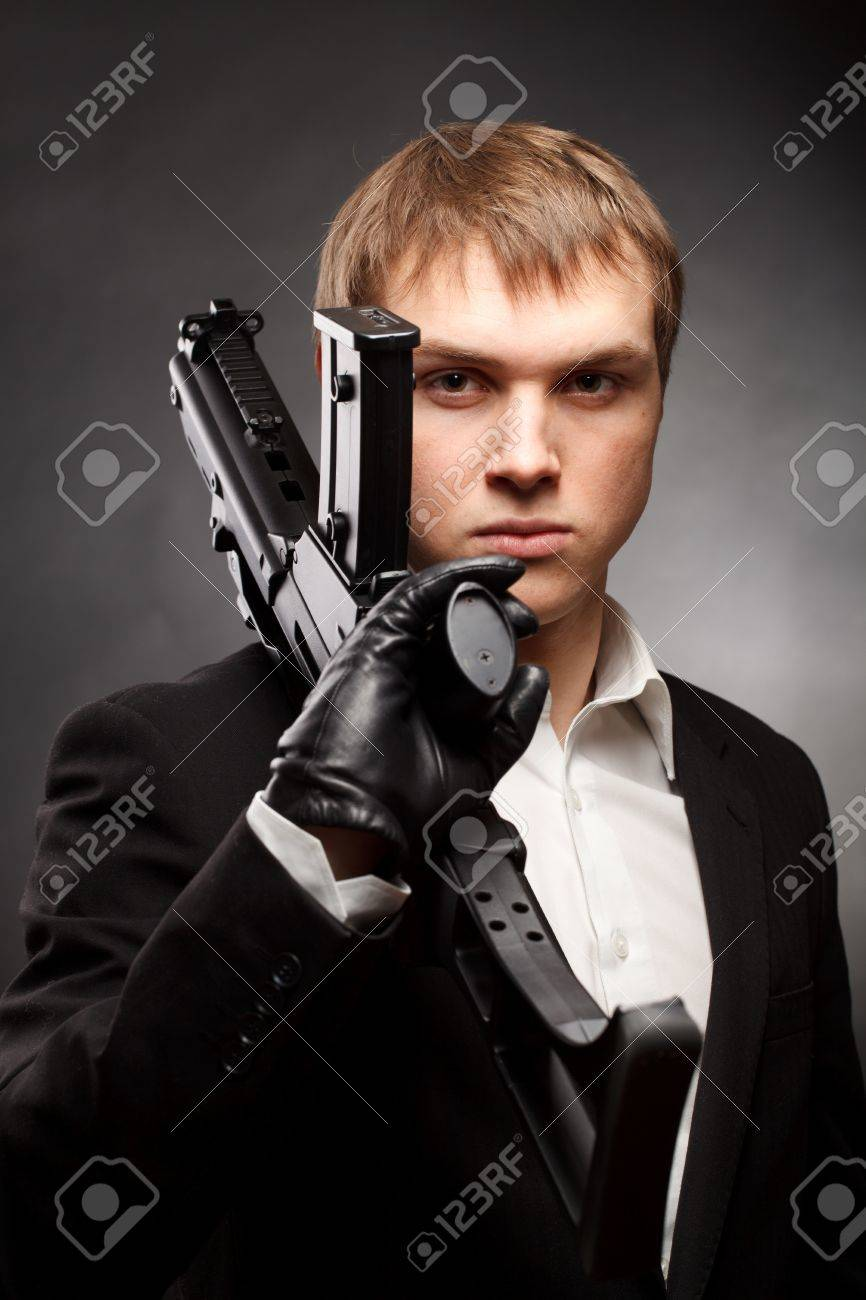 Man with gun over gradient gray Stock Photo - 8996861