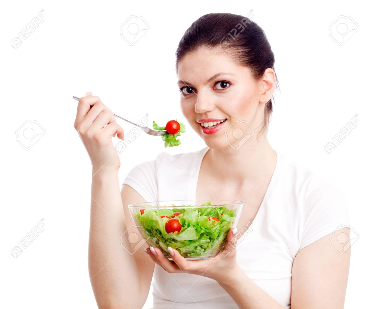 Young woman with healthy salad. Isolated over white. Stock Photo - 9754295