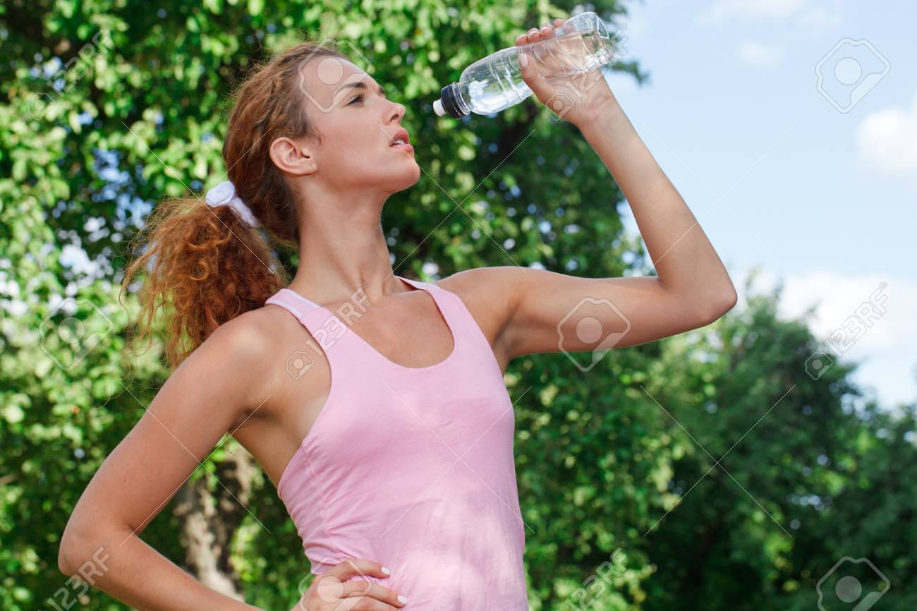 Woman drink water after jogging Stock Photo - 9755134