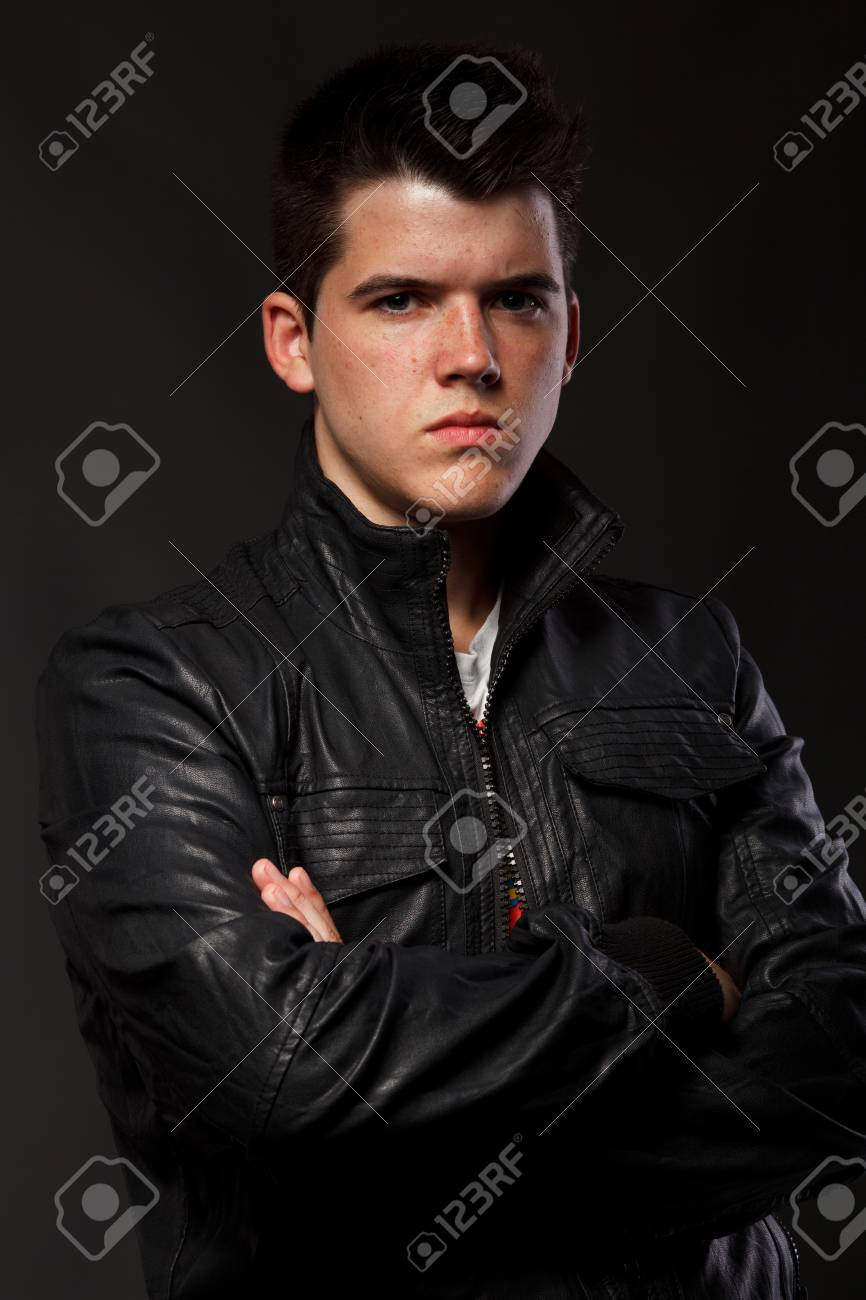 Portrait of young man over dark background. Stock Photo - 10411660
