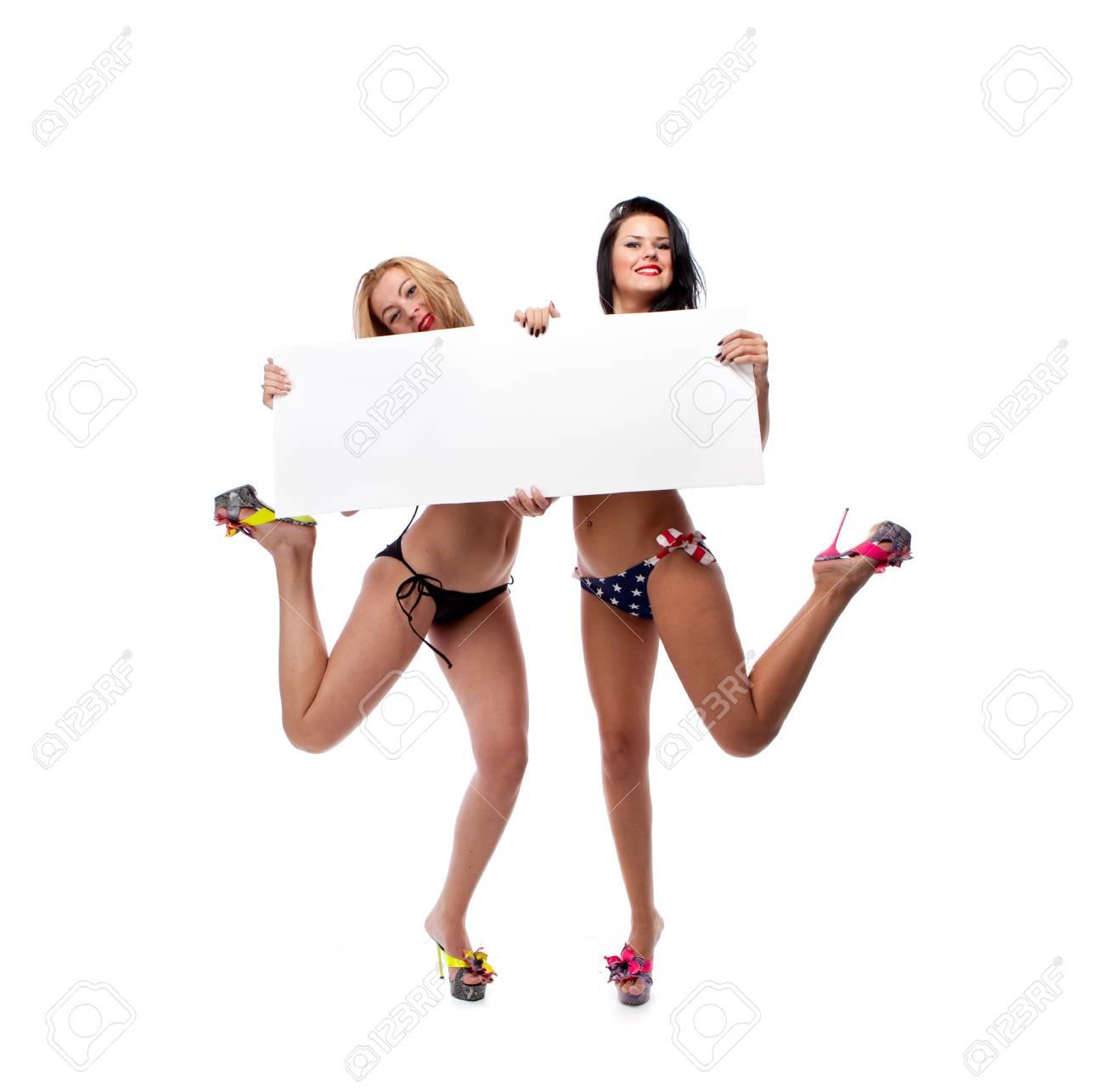 Young women holding blank billboard Stock Photo - 12525842