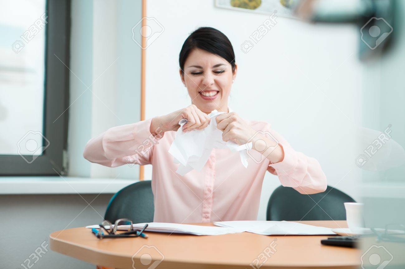Woman In Office With Crumpled Paper Office Life Concept Stock