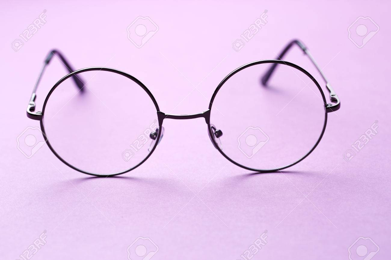67a85c347b0 Round frame glasses with clear lenses on empty purple background Stock  Photo - 66036793