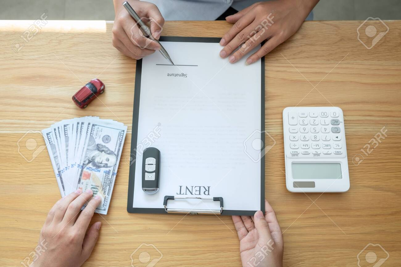 Car rental and Insurance concept, Young salesman receiving money and giving car's key to customer after sign agreement contract with approved good deal for rent or purchase. - 137028656