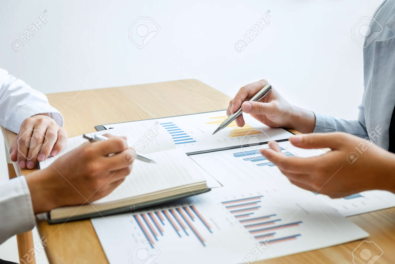 Two business partner team conference and discussion in investment ideas marketing planning and presentation finance project at meeting and strategy of business making to growth of profit. - 137028558