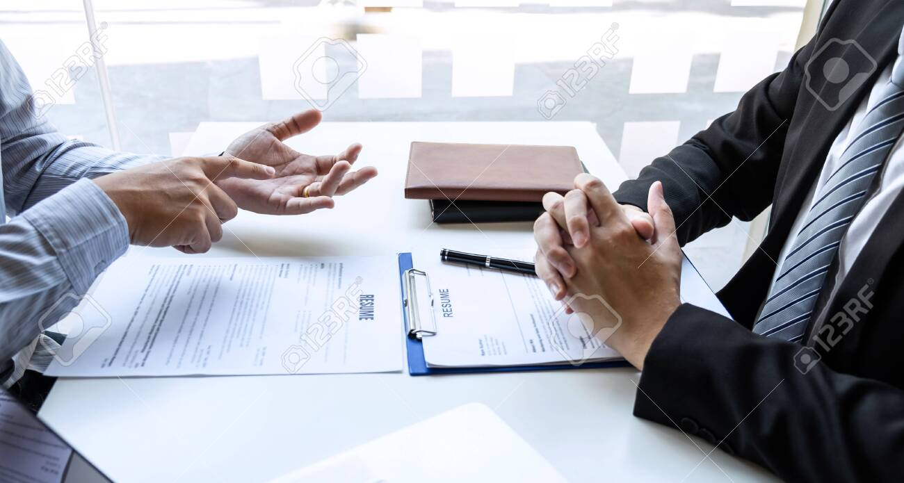 Businessman interview consider a resume conversation during about profile of candidate of conducting a job interview listen to answers while sitting at the working meeting in office. - 138796176
