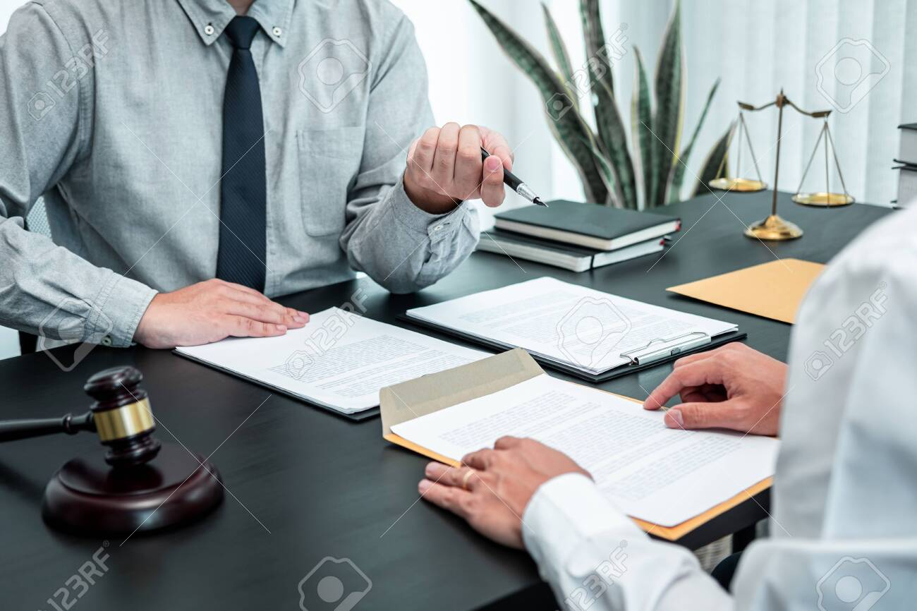 Male lawyer discussing negotiation legal case with client meeting with document contract in office, law and justice, attorney, lawsuit concept. - 158246440
