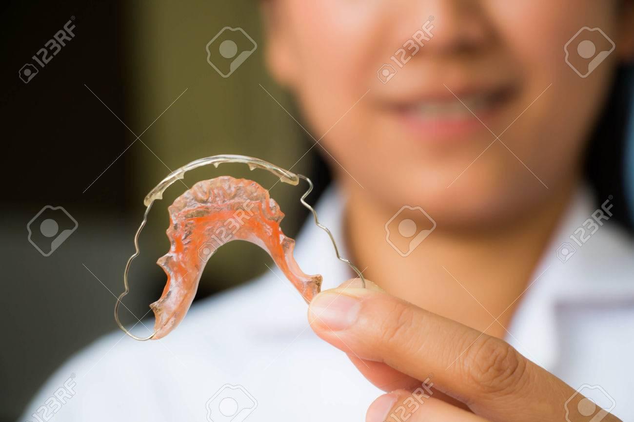 Dentist holding retainer Stock Photo - 27635044