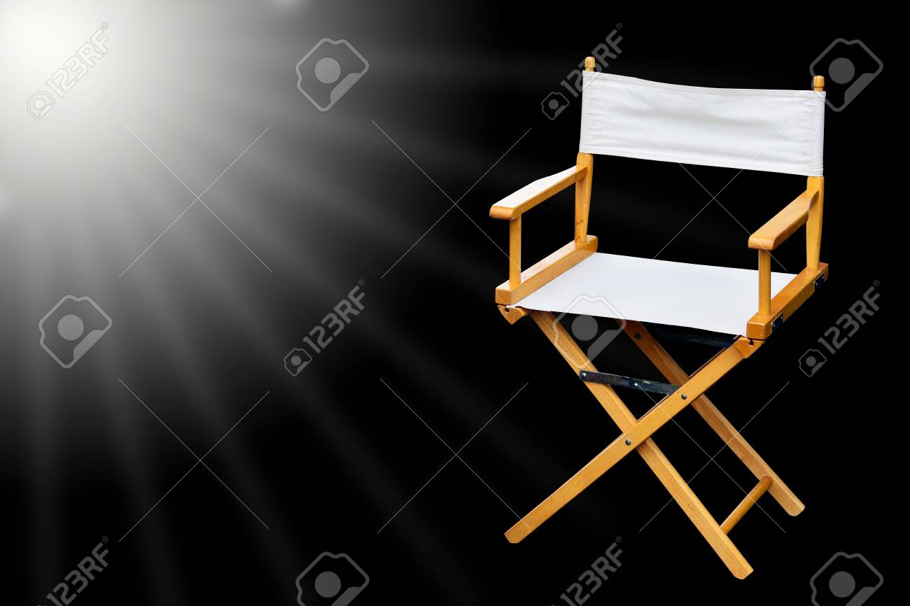 Film director chair or movie film industry of concept on light black color background Stock Photo & Film director chair or movie film industry of concept on light..