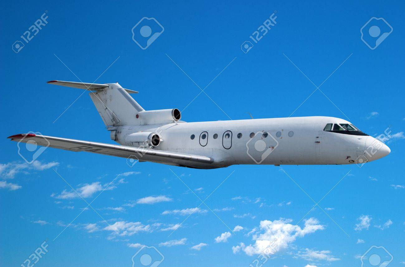 Airplane flying against the blue sky Stock Photo - 5417702