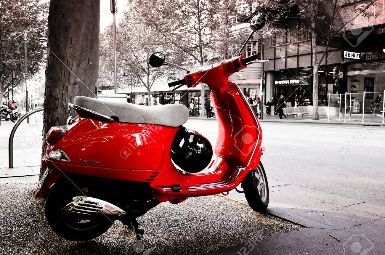A Red Coloured Vespa On The Streets Of Melbourne Stock Photo