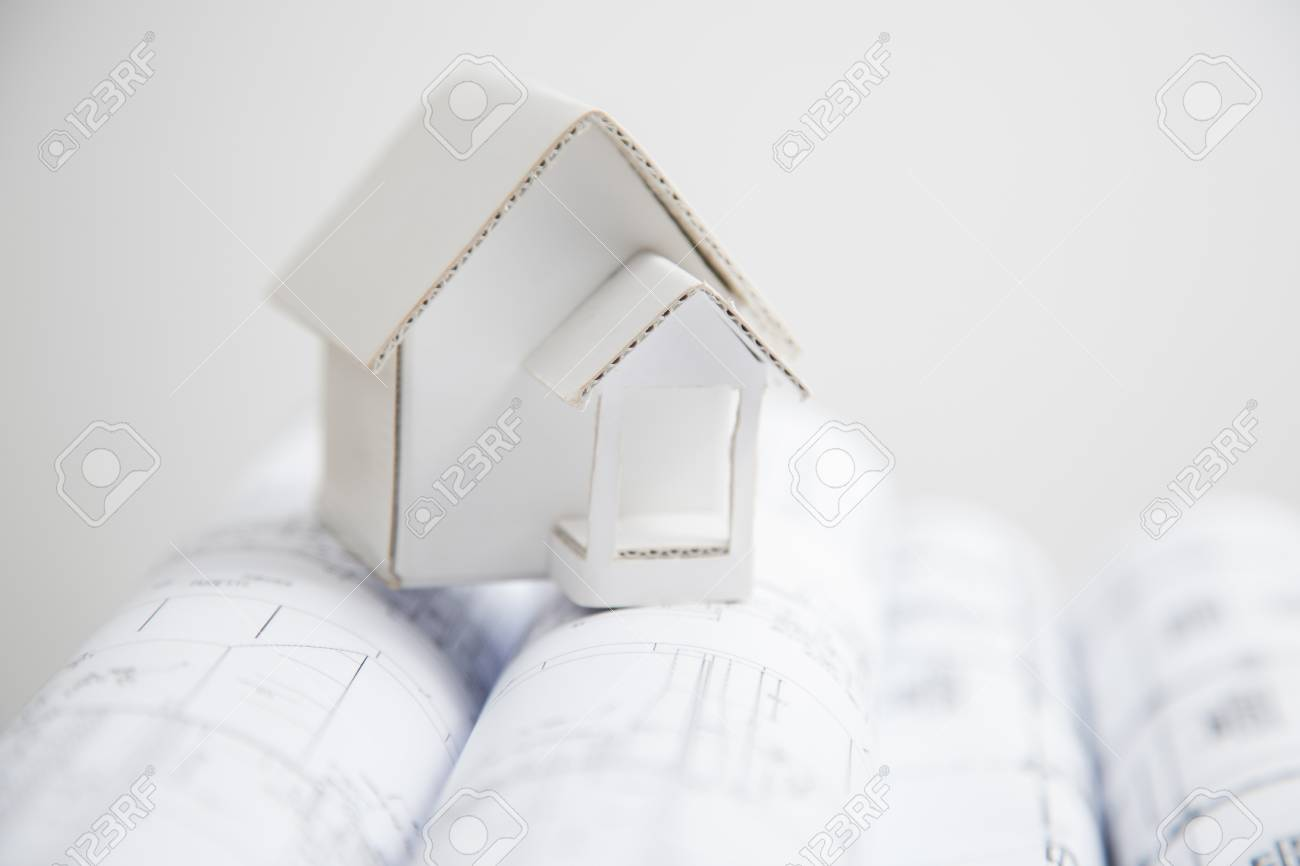 Paper model house on a blueprint stock photo picture and royalty paper model house on a blueprint stock photo 23236111 malvernweather Image collections