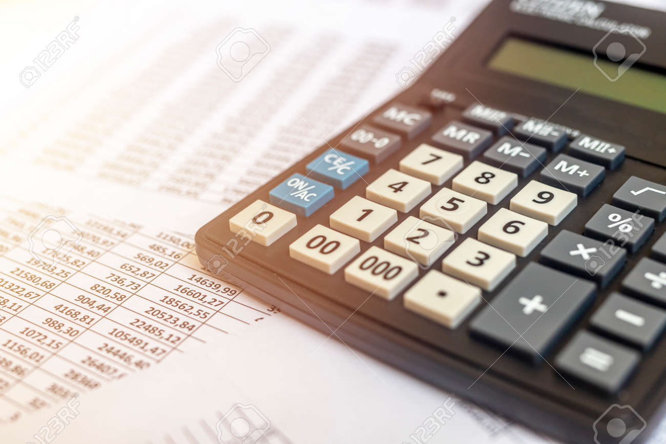 Document - Personal or corporate Budget with a calculator and documents with table of digits on office table, financial accounting concept - 154685056