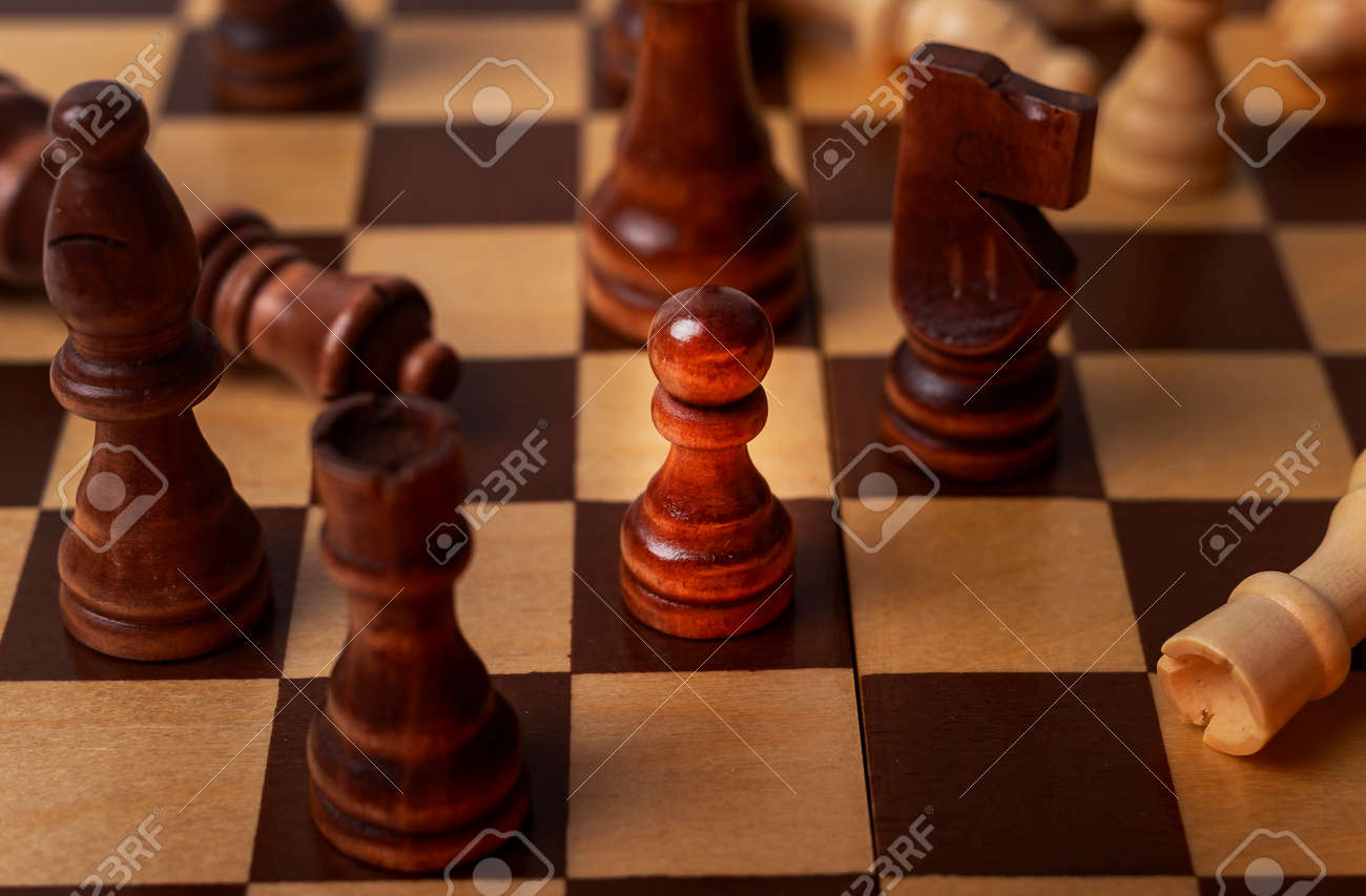 Pawn among other chess pieces, close up. - 165400927