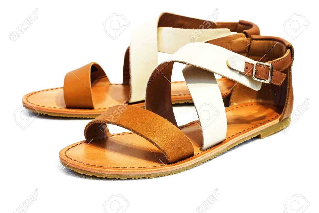 5dcf62e3402b2 Beautiful photo of female leather sandals isolated on white background.  Stock Photo - 30450988