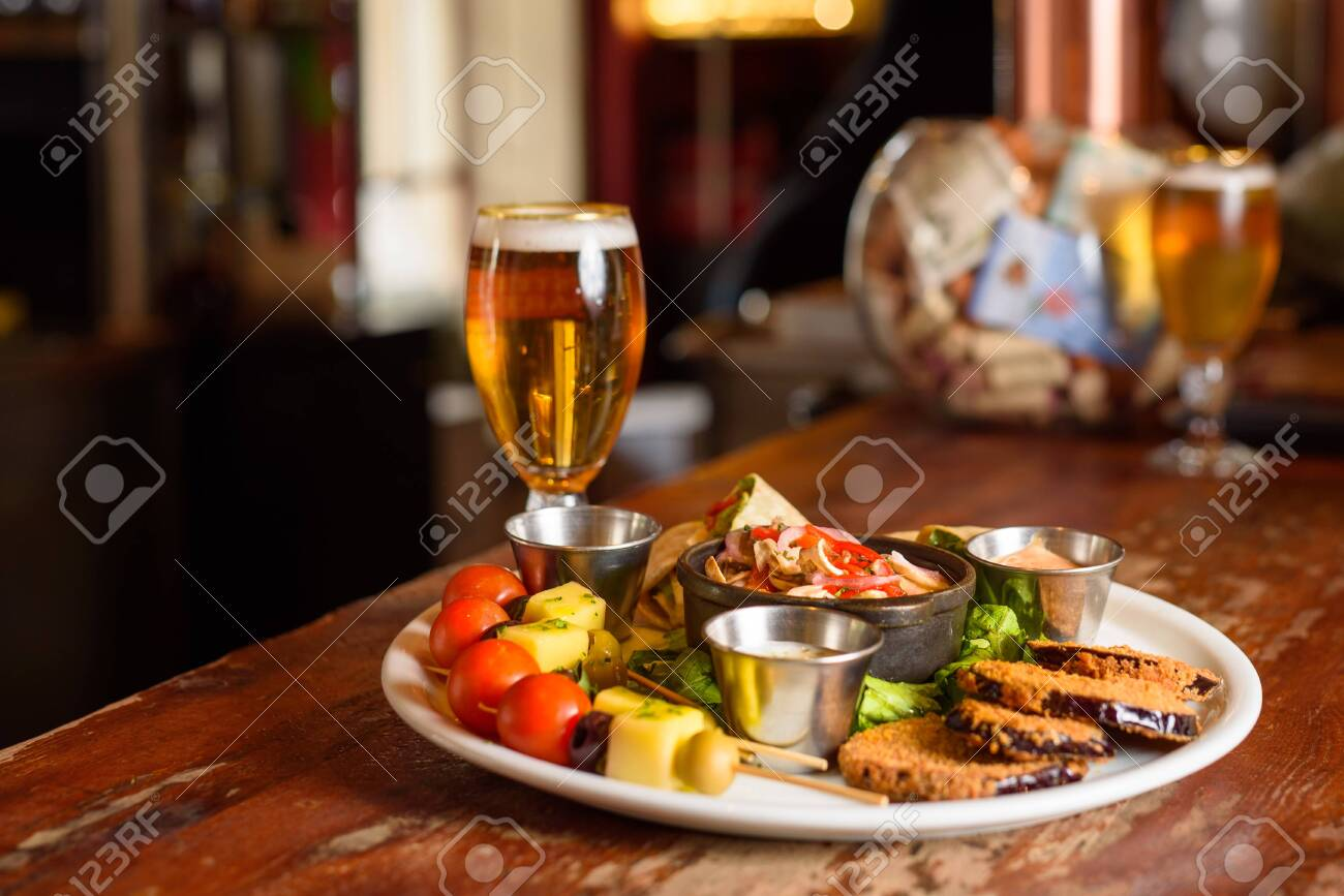 a Chilean meat platter with a cold beer - 144788367