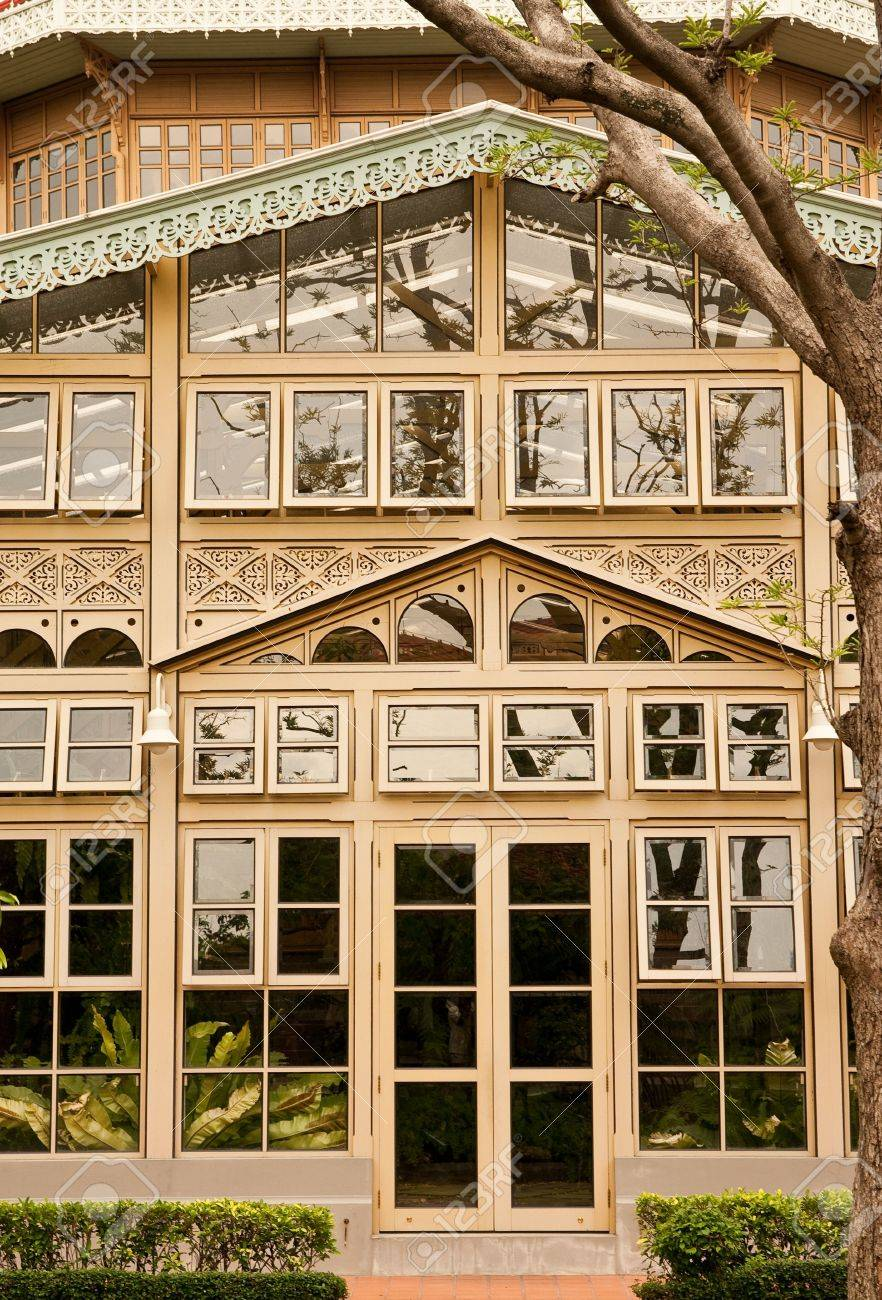 Glass house and exquisite wood carving vimanmek palace bangkok thailand stock photo