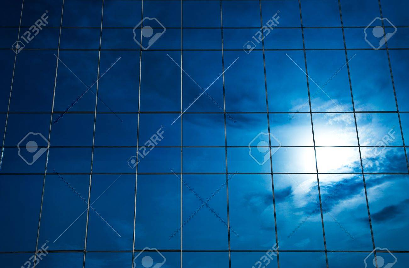 Reflection of cloud and sun in  glass building Stock Photo - 7651287