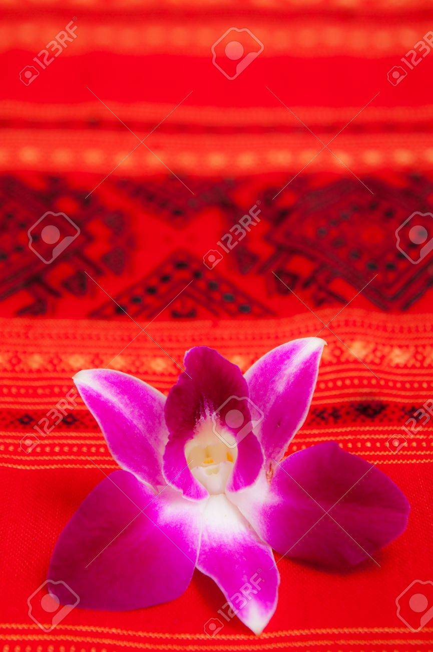 Cattleya orchid on native Thai style cloth Stock Photo - 7650607