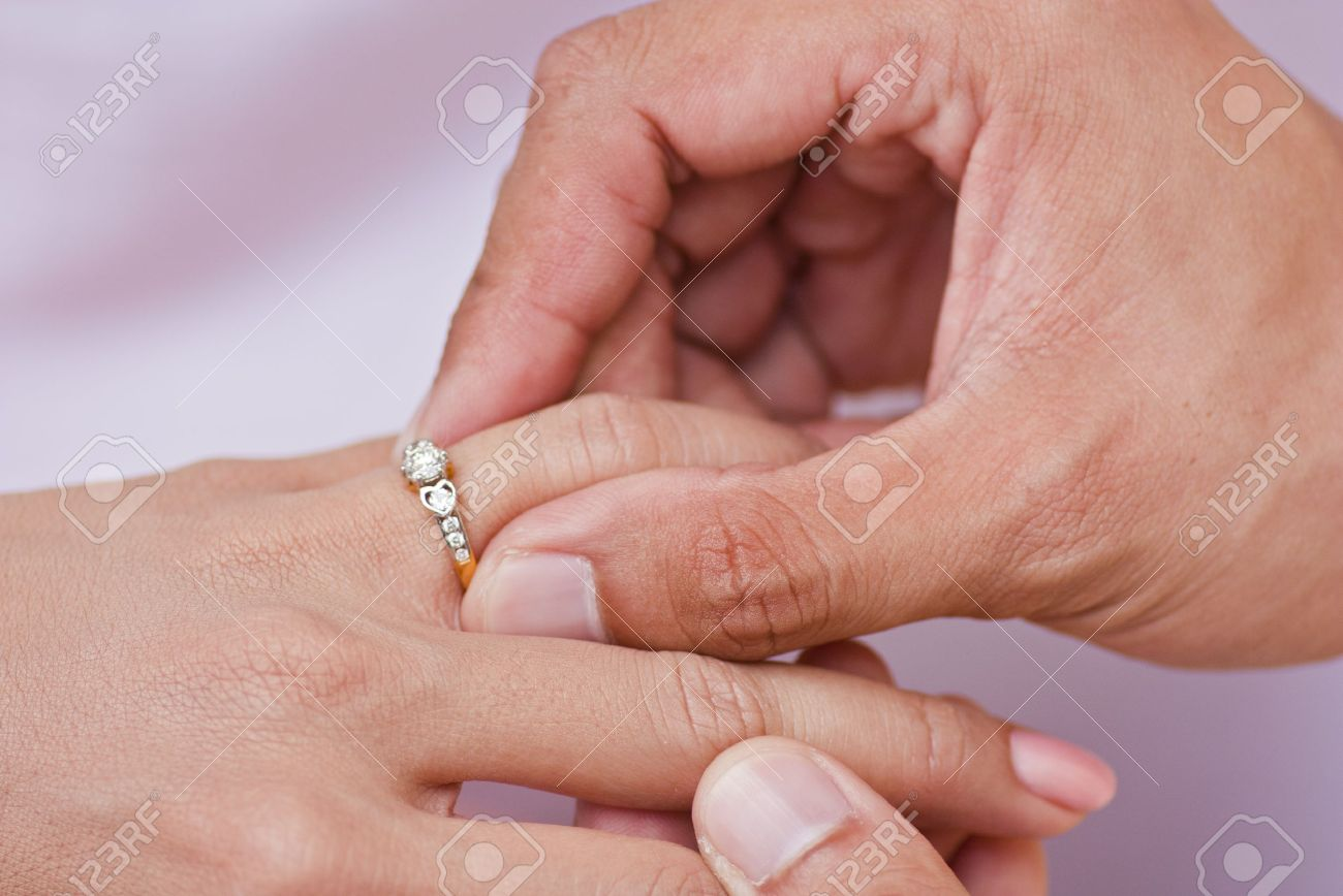 Male Hand Wear Diamond Ring In To Female Finger Stock Photo  11698022