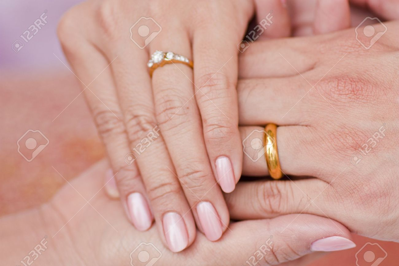 Female And Male Hand Wearing Engagement Ring Hold Hand In Hand Stock