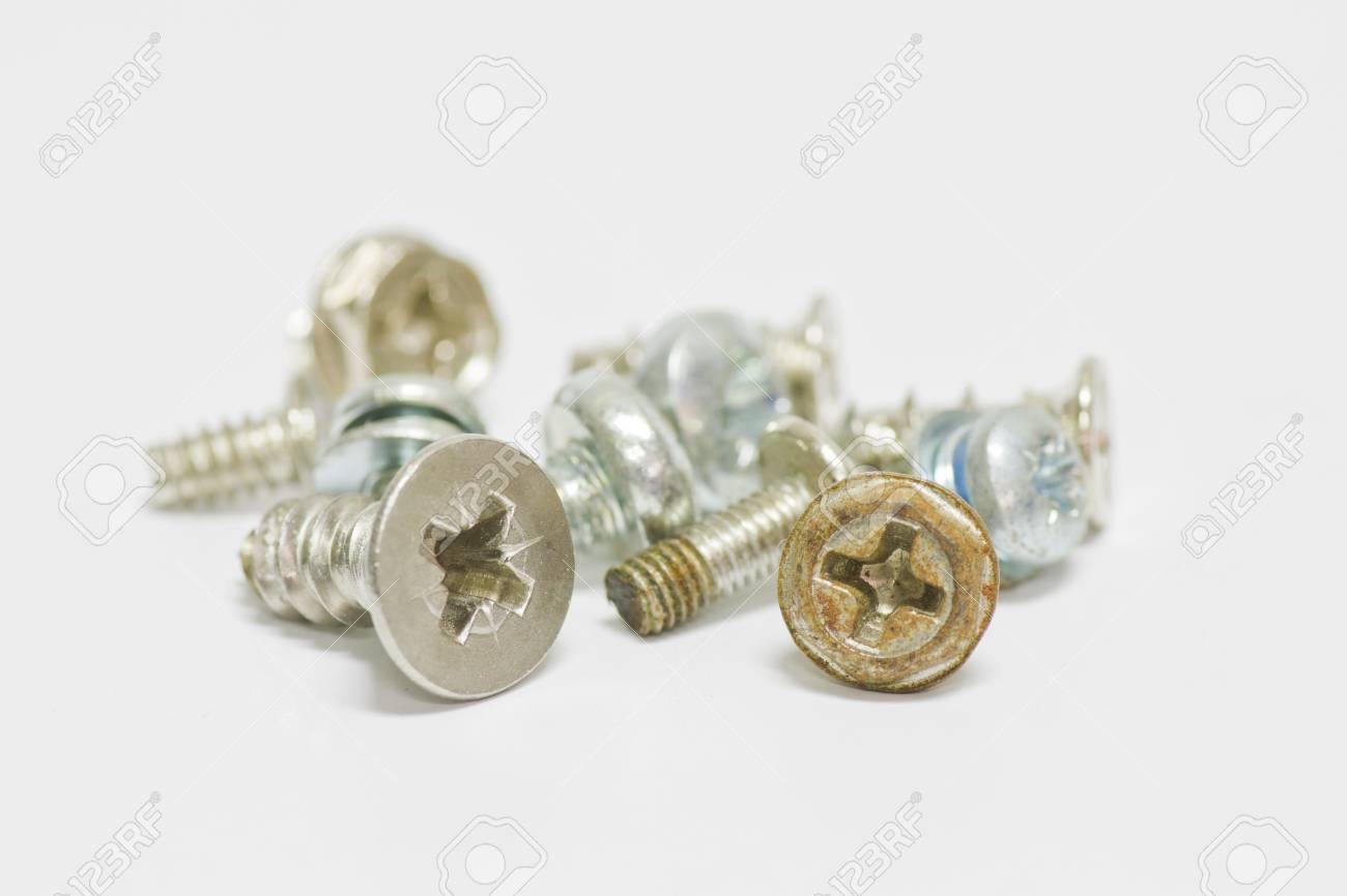 Little screws on white background with shallow focus Stock Photo - 13797738