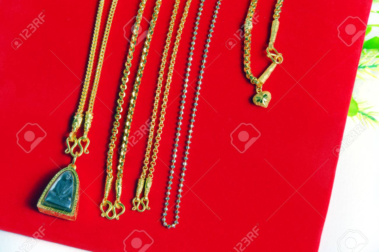 Gold necklace 965 precent thai gold design with buddha and gold gold necklace 965 precent thai gold design with buddha and gold frame pendant isolated on red aloadofball Choice Image