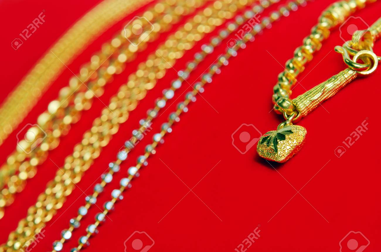 Gold necklace 965 precent thai gold design with gold heart pendant gold necklace 965 precent thai gold design with gold heart pendant isolated on red flannel cloth aloadofball Choice Image