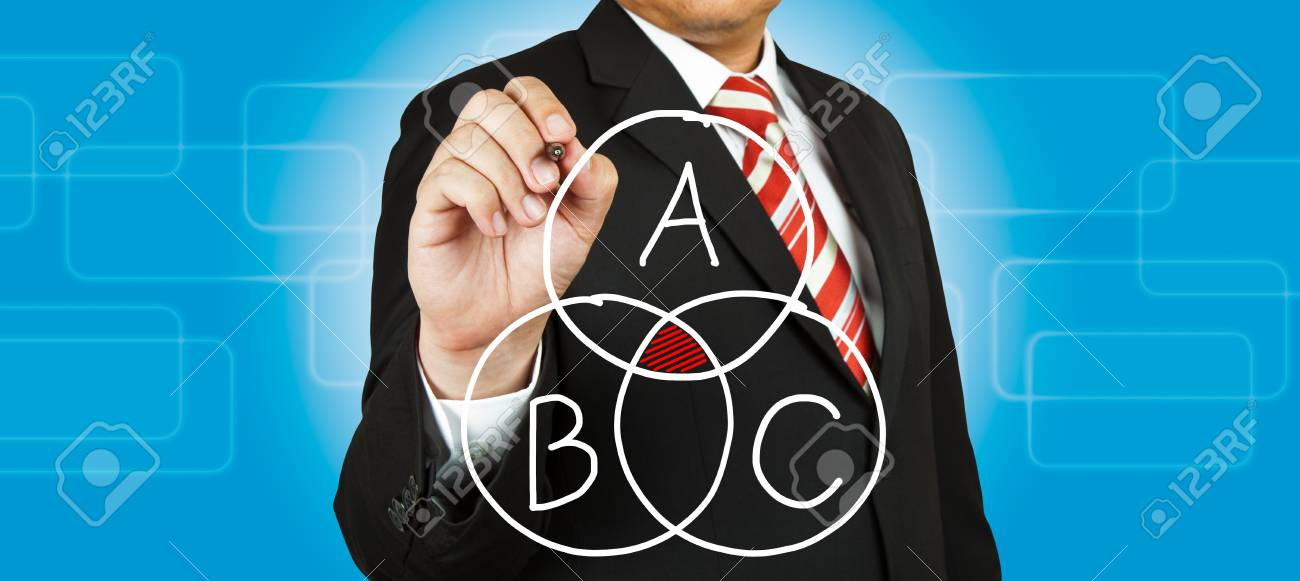 Businessman drawing intersected circle diagram and shadow the intersection Stock Photo - 14854491