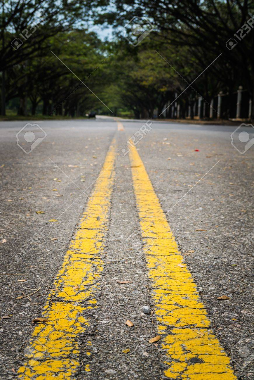 Double yellow lines on the street Stock Photo - 17245389